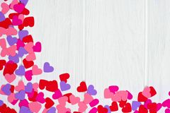 Valentines Day paper heart corner border against white wood Royalty Free Stock Image