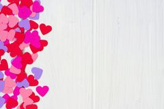 Valentines Day paper heart side border against white wood Stock Images