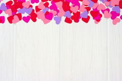 Valentines Day paper heart top border against white wood Stock Image