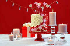 Valentines Day party table with showstopper hearts cake. Stock Photos