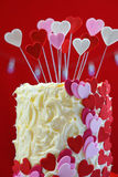 Valentines Day party table with showstopper hearts cake. Stock Image