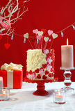 Valentines Day party table with showstopper hearts cake. Stock Photography