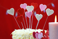 Valentines Day party table with showstopper hearts cake. Royalty Free Stock Images