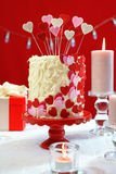 Valentines Day party table with showstopper hearts cake. Royalty Free Stock Photo