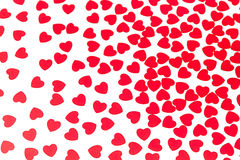 Valentines day pattern of red hearts confetti on white background. stock image