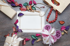 Valentines day photo frame or greeting card and handmade hearts over wooden table. Stock Images