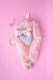 Valentine's day pink background with heart, silk ribbon and shells on a veil. Romantic greeting card, invitation design top Stock Images