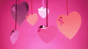 Valentines Day Pink Background A Lot of Valentines. Valentine`s Day Bunch Of Hearts Swinging Pink colour stock footage