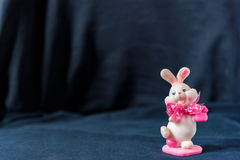 Valentines day pink bunny souvenir on black background Royalty Free Stock Photos
