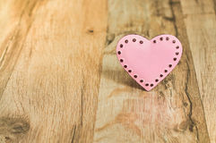 Valentines Day with pink heart. Heart with place for text on the wooden background Royalty Free Stock Images