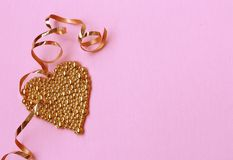 Valentines Day pink paper background, gold heart Royalty Free Stock Photo