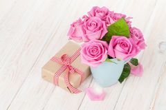 Valentines day pink roses bouquet and gift box Royalty Free Stock Images