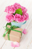 Valentines day pink roses bouquet and gift box Royalty Free Stock Image