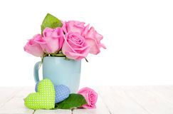 Valentines day pink roses bouquet and handmaded toy hearts. On white wooden table Stock Images