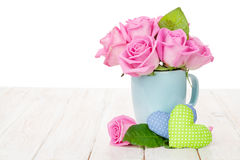 Valentines day pink roses bouquet and handmaded toy hearts Royalty Free Stock Photo