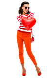 Valentines day portrait of Pretty Mixed race woman holding red h Stock Photo