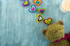 Valentines Day postcard. Teddy Bear and colourful hearts Stock Photography