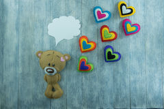Valentines Day postcard. Teddy Bear and colourful hearts Stock Photo