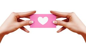 Free Valentines Day Postcard With Shape Heart In Female Hand On White Background. Pink Gift Card. Love And Happiness Symbol Stock Photography - 107751902