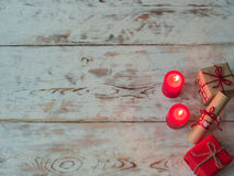 Valentines day red candles, gift boxes on old wood. Holidays card with copy space. stock image
