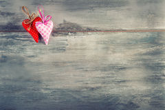 Valentines day. Red cloth handmade hearts on wooden background Stock Photography