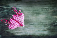 Valentines day. Red cloth handmade hearts on wooden background Royalty Free Stock Photos