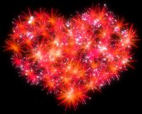 Valentines Day red Fireworks heart shape. Over black Stock Photos