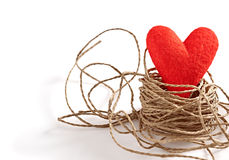 Valentines Day. Red handmade heart in nest  of twine Stock Photography