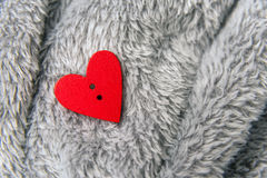 Valentines day red heart on bedspread Royalty Free Stock Photography