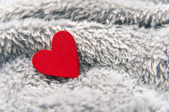 Valentines day red heart on bedspread Royalty Free Stock Image