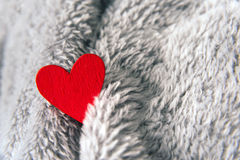 Valentines day red heart on bedspread Stock Photos