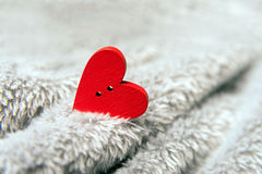 Valentines day red heart on bedspread. Royalty Free Stock Photos