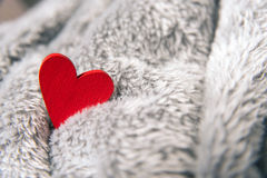Valentines day red heart on bedspread Royalty Free Stock Photo