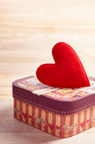 Valentines Day. Love heart handmade gift box, wood. Valentines Day. Love red heart handmade on gift box. Retro romantic styled. Vintage concept on wooden Royalty Free Stock Photo