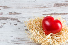 Valentines day. A red heart on a rustic background royalty free stock image