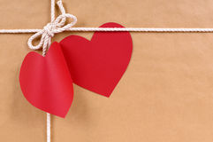 Valentines day red heart shape gift tag, brown paper package par. Cel background Royalty Free Stock Photos