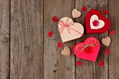 Valentines Day red heart shaped gift boxes over wood Royalty Free Stock Photos