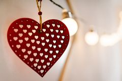 Valentines day. Red heart with vintage old wood on background pi. Cture bokeh and bulbs light. love Stock Images