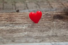 Red heart on wooden background stock photography