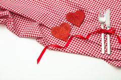 Valentines day. Red hearts on red checkered table cloth, white background, copy space, top view stock photo