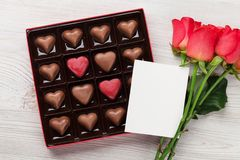 Valentines day with red roses and chocolate Royalty Free Stock Images