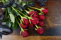 Valentines Day red roses on dark recycled wood Stock Image