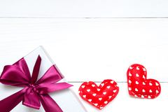 Valentines day toy hearts and gift box on the white wooden table, copy space royalty free stock image