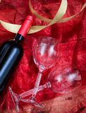 Valentines day. Red wine bottle and glasses on red textile. Valentines day concept. Red wine bottle and glasses on red textile royalty free stock photography