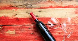 Valentines day. Red wine bottle and glasses on wooden background. Valentines day concept. Red wine bottle and glasses on wooden background stock images