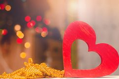 Valentines day, red wooden heart. concept love. romantic decorations stock photography