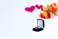 Valentines Day. Rings in the foreground. White background. Valentine`s Day. Wedding. Engagement. Feelings Royalty Free Stock Photo