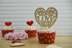 Valentines day romantic cup cakes in strawberry and cream flavor with big love heart decoration on top. Romantic valentine day food of a handmade strawberry Royalty Free Stock Image