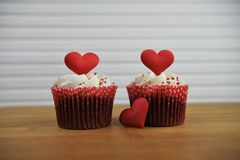 Valentines day romantic cup cakes in strawberry and cream flavor with red love heart decorations on top. Romantic valentine day food of a handmade strawberry Stock Image