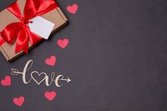 Valentines day romantic seamless black background, gift tag bow, present,love,hearts,copy text space. Gift tag bow, present,love,hearts,copy text space stock photo